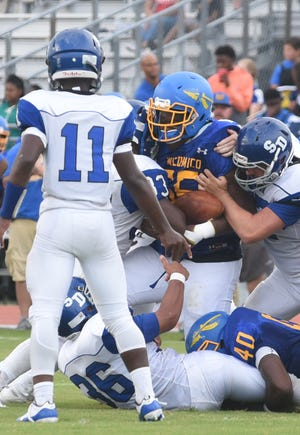 Wi-Hi's Dominic Bailey recovers a fumble during game action Friday, Sept. 7, 2018 at Wicomico High School in Salisbury. Wi-Hi won the game 18-8.