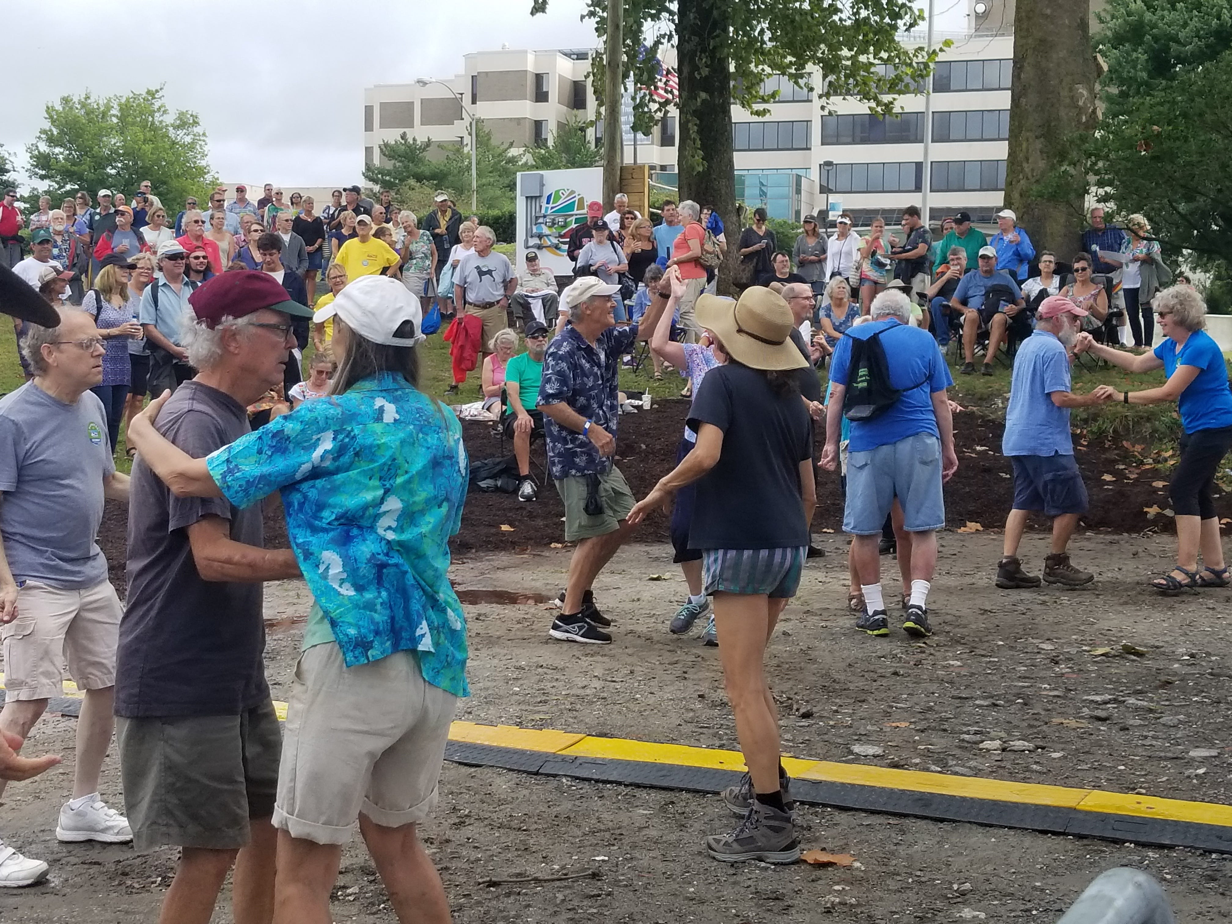 Dancers cut a rug as Steve Riley and the Mamou Playboys perform Saturday on the PRMC stage during the National Folk Festival.