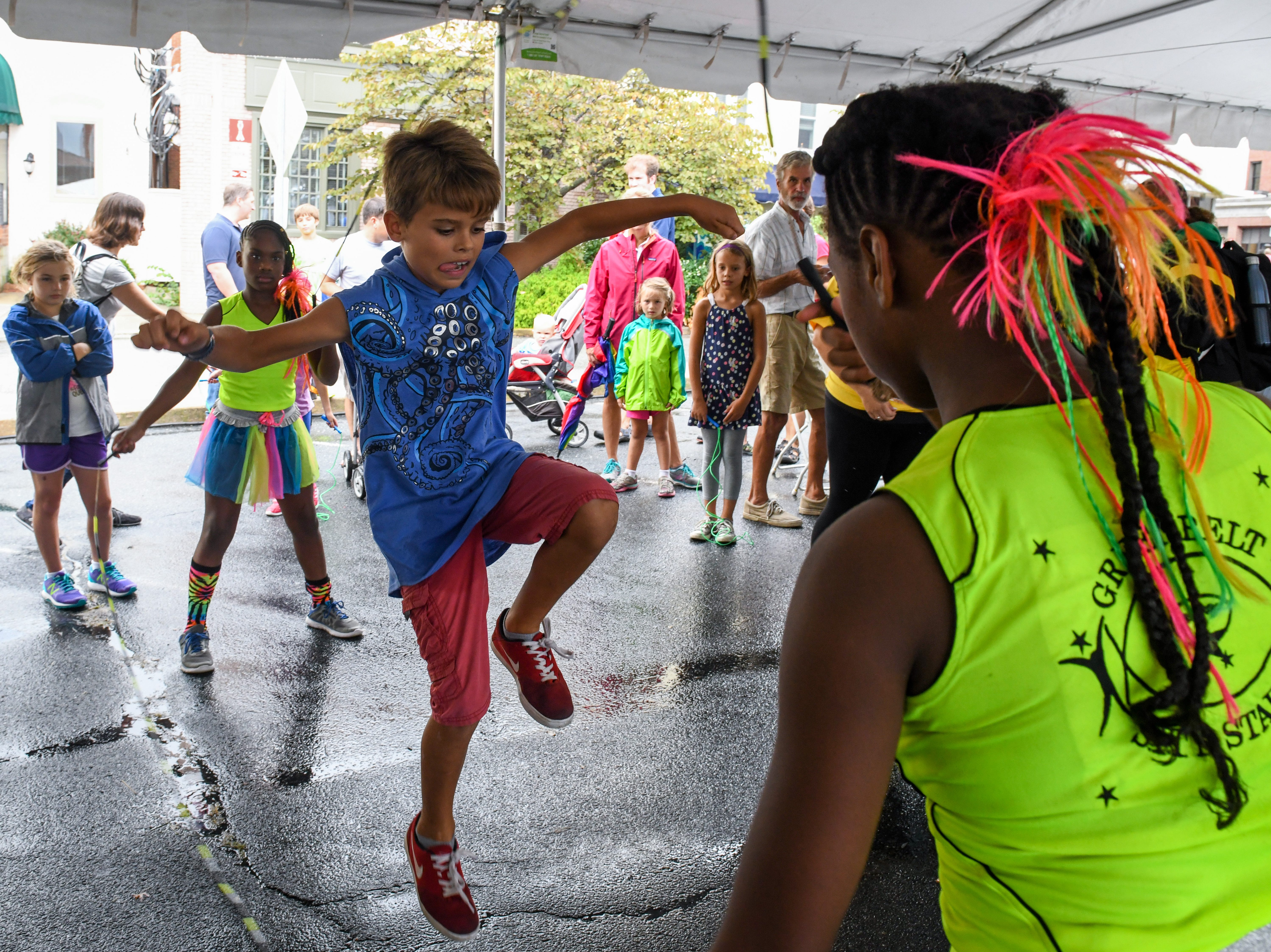 10-year-old Wyatt Tolker jumps rope with the Greenbelt S.I.T.Y Stars precision jumprope team at the National Folk Festival in Salisbury on Saturday, Sept. 8.