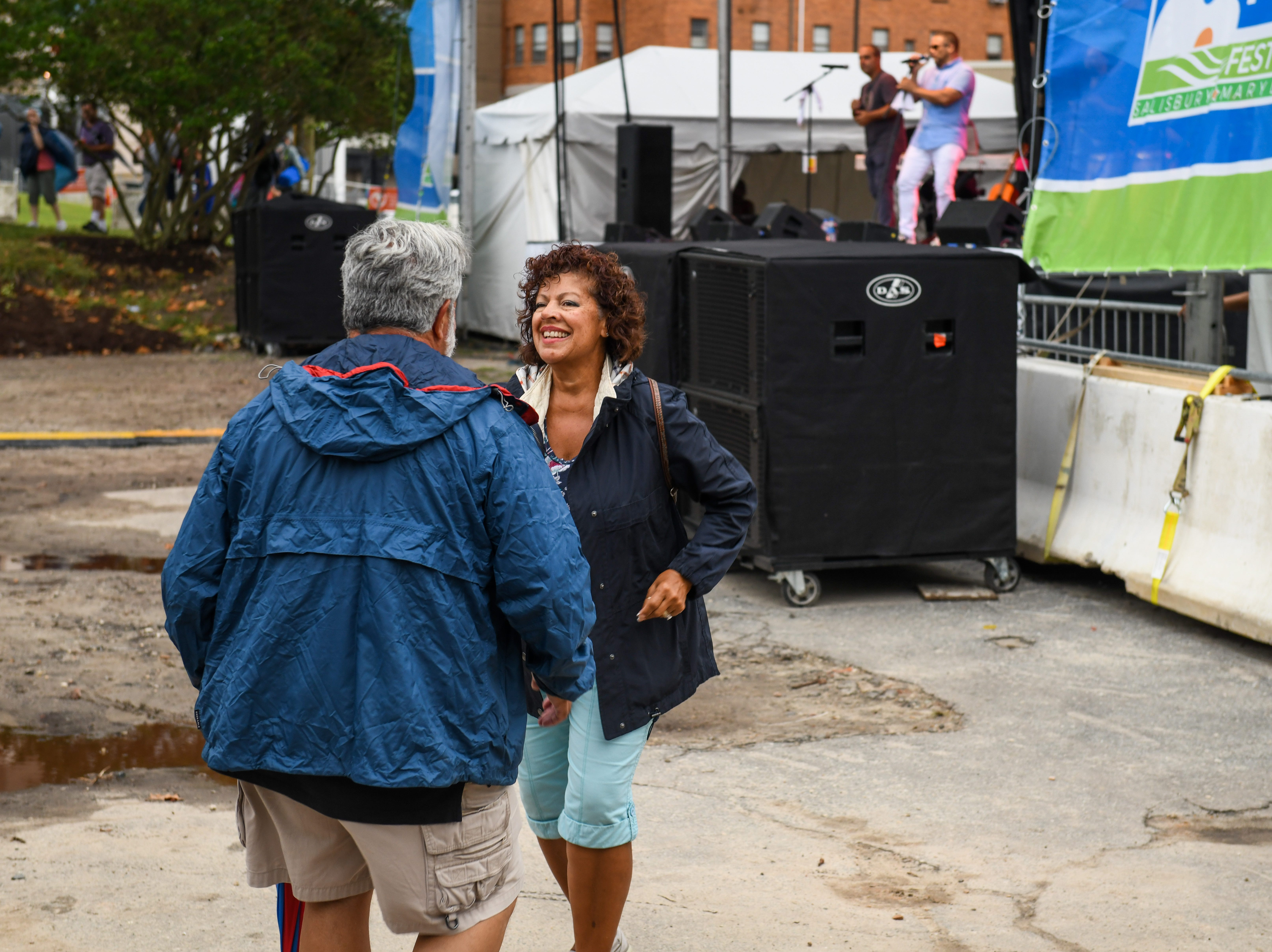 Lisa and Frank Parrino dance to the music of Orquesta SCC at the National Folk Festival in Salisbury on Saturday, Sept. 8.