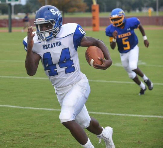 Stephen Decatur's London Drummond runs for a touchdown in Friday's game at Wicomico High School in Salisbury.