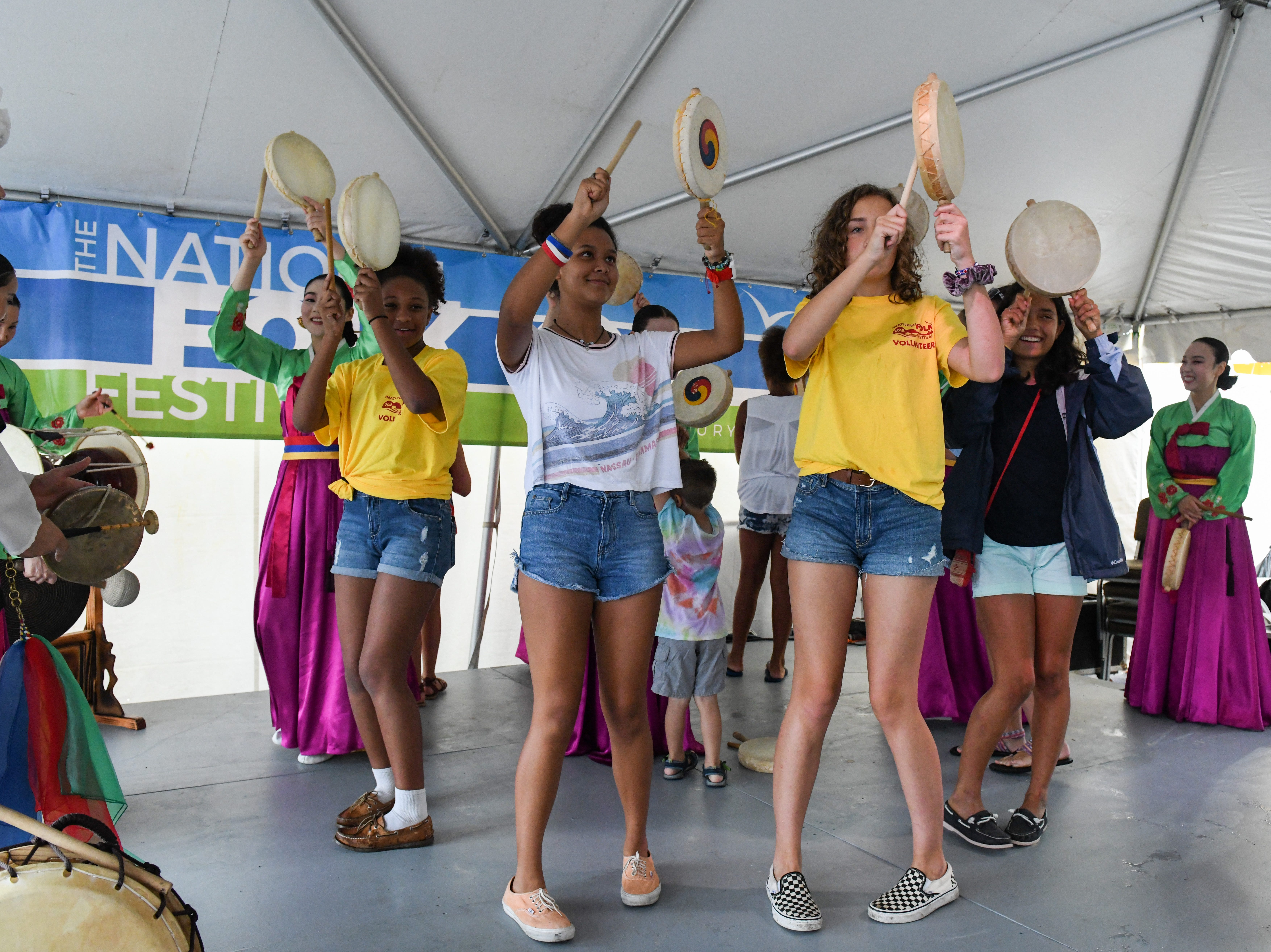 Crowd members learn a dance from the Sounds of Korea group at the National Folk Festival in Salisbury on Saturday, Sept. 8.
