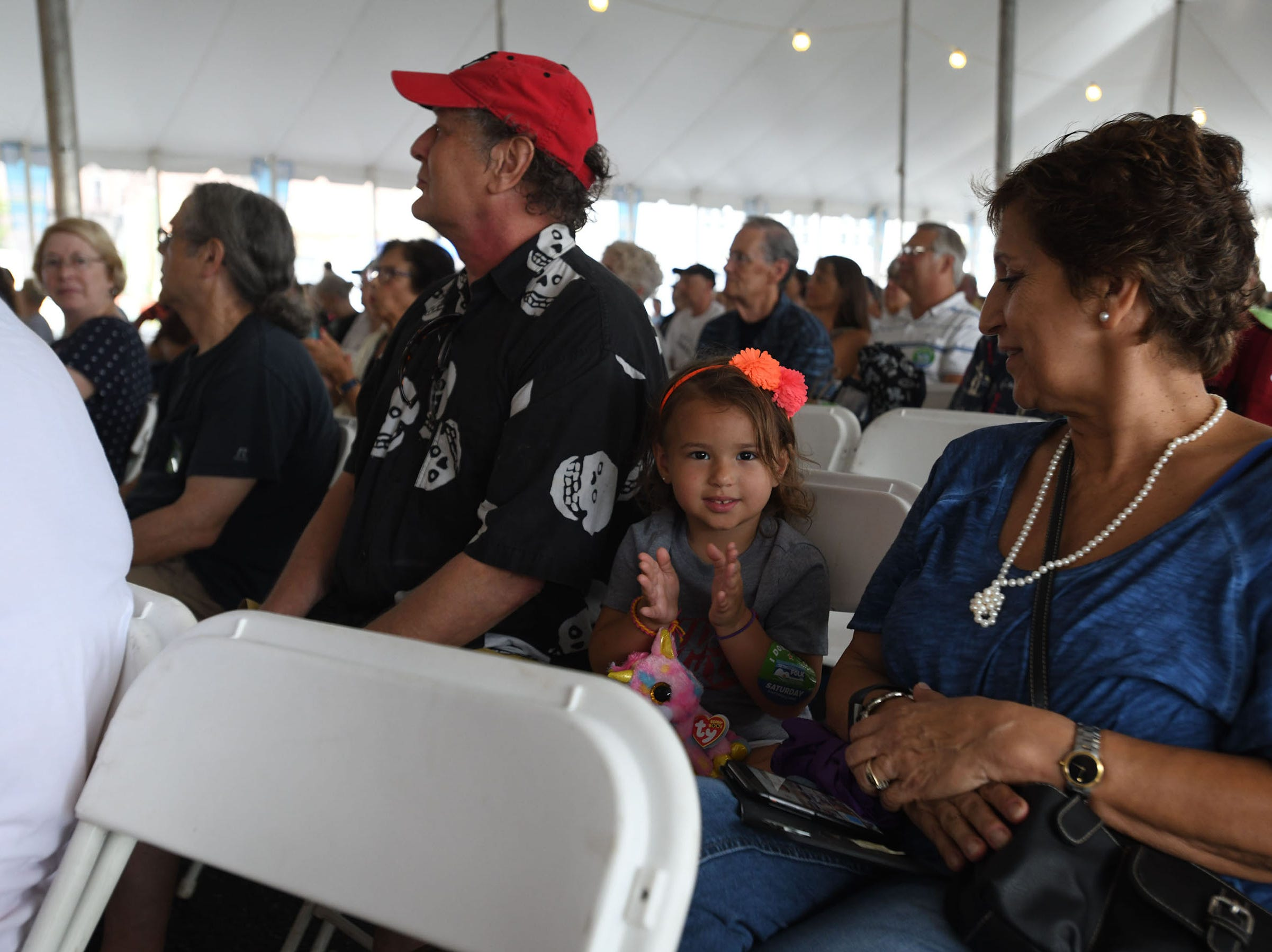 A little girl claps along with the Mariachi Band during the 78th National Folk Festival on Saturday, Sept. 8, 2018 in Salisbury, Md.