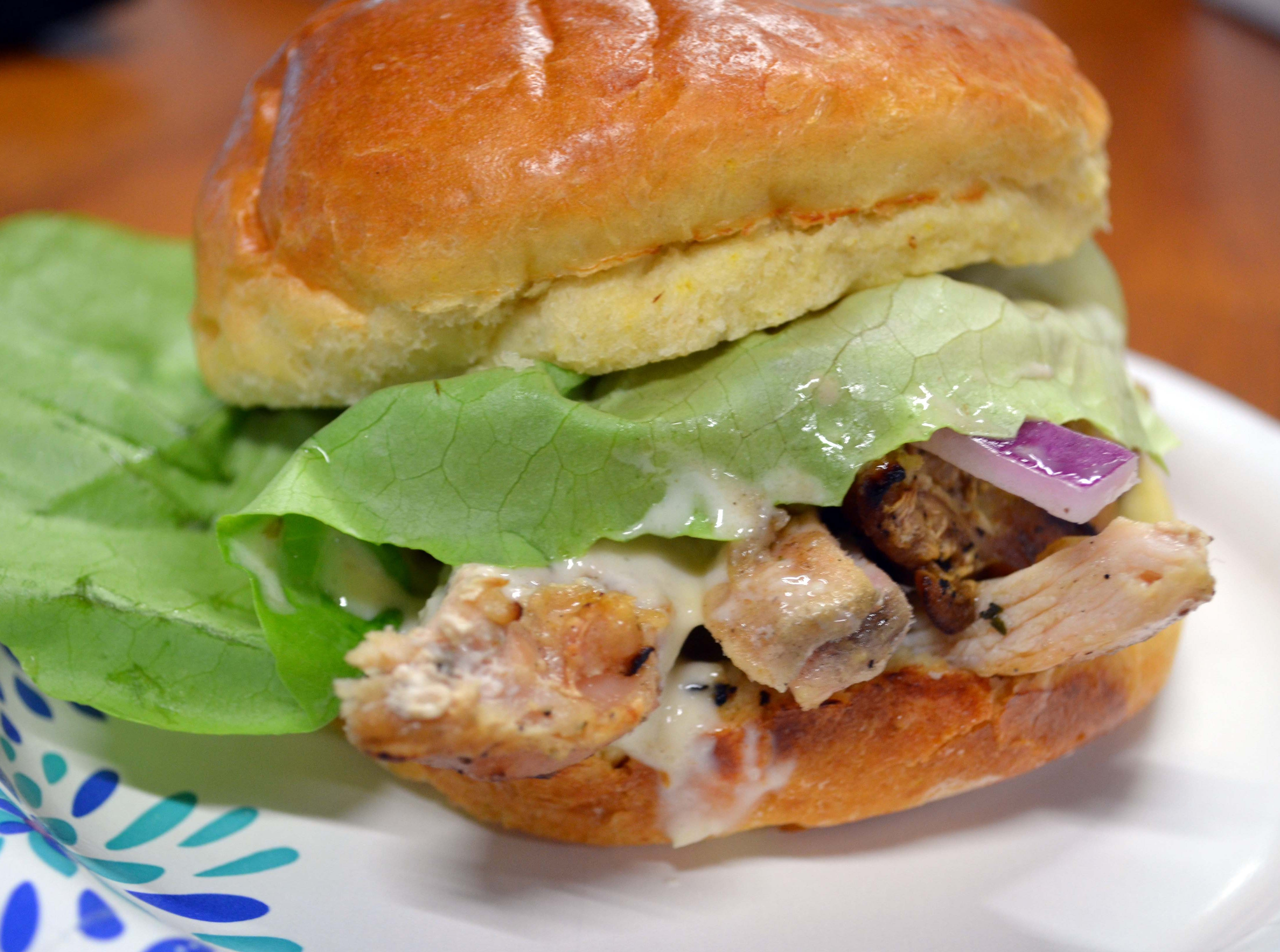 Grilled chicken sandwiches with pineapple garlic sauce are offered at the Perdue Farms food truck during the National Folk Festival in Salisbury, Maryland on Sept. 7-9, 2018 in Salisbury, Maryland.