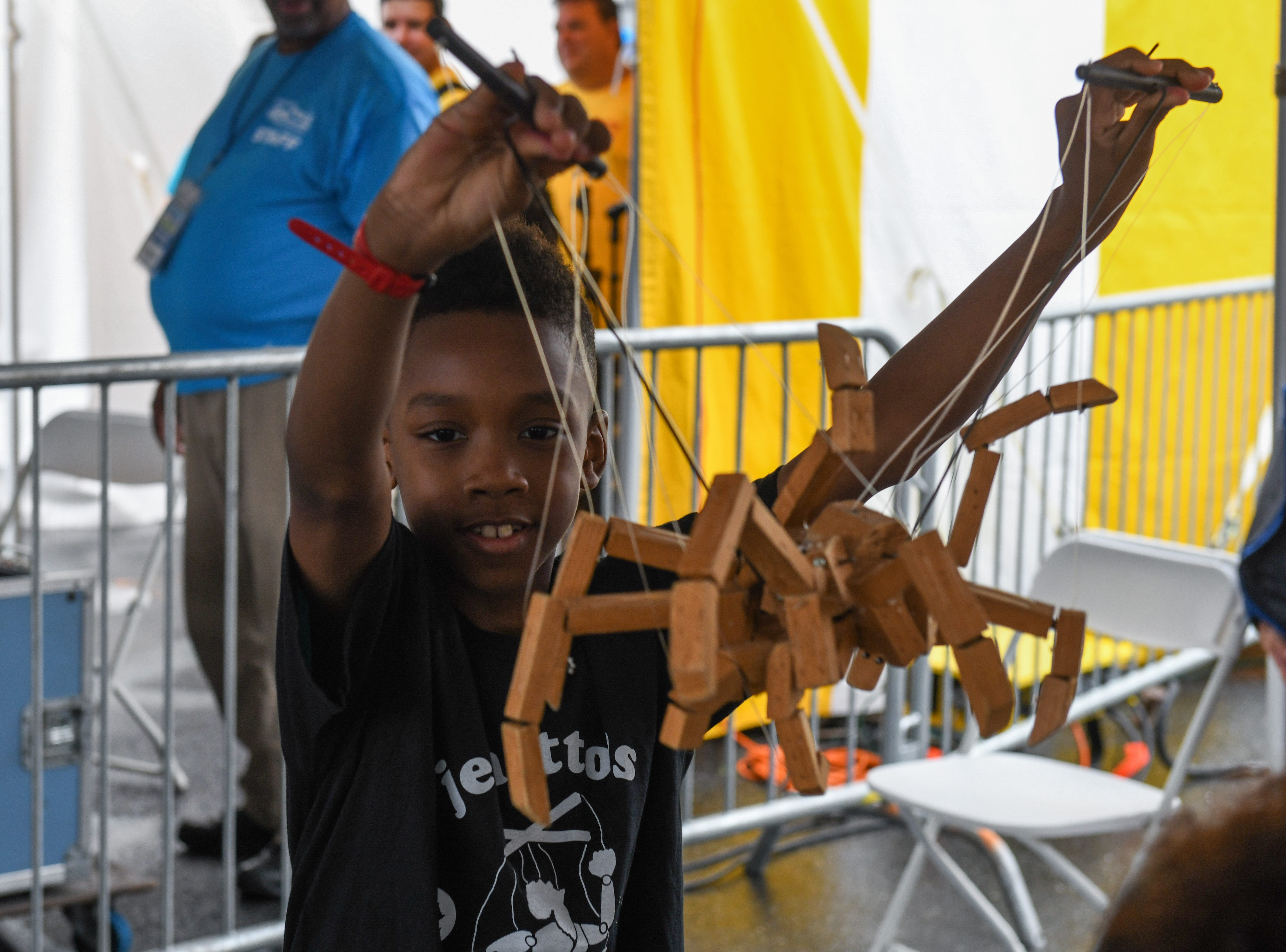 Tarin Papkins performs with the Jeghetto puppetry group at the National Folk Festival in Salisbury on Saturday, Sept. 8.