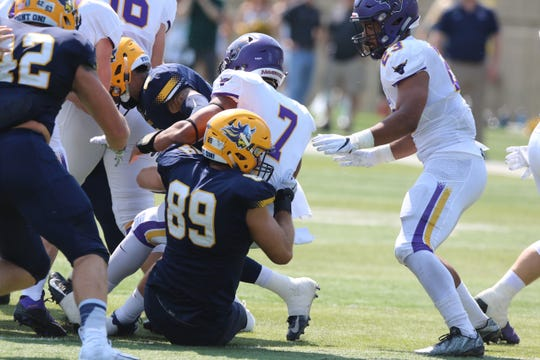 Augustana's Jr DE #89 Jack Wilson tackles Minnesota State's QB #7 JD Ekowa during their game against Minnesota State-Mankato.