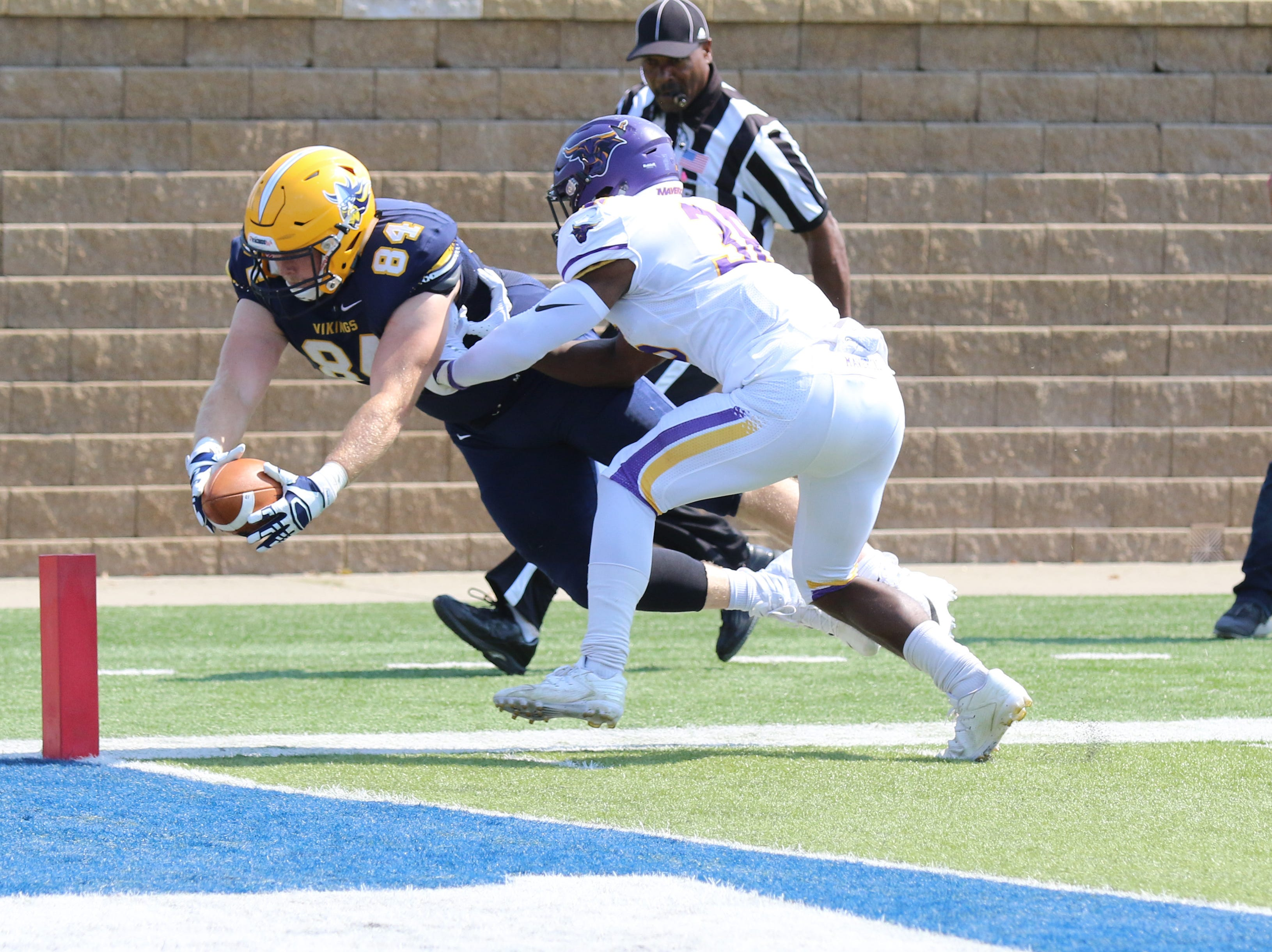 Augustana's Sr tight end #84 Chet Peerenboom dives to the endzone for the score in their game against Minnesota State-Mankato. Minnesota State won 38-36.