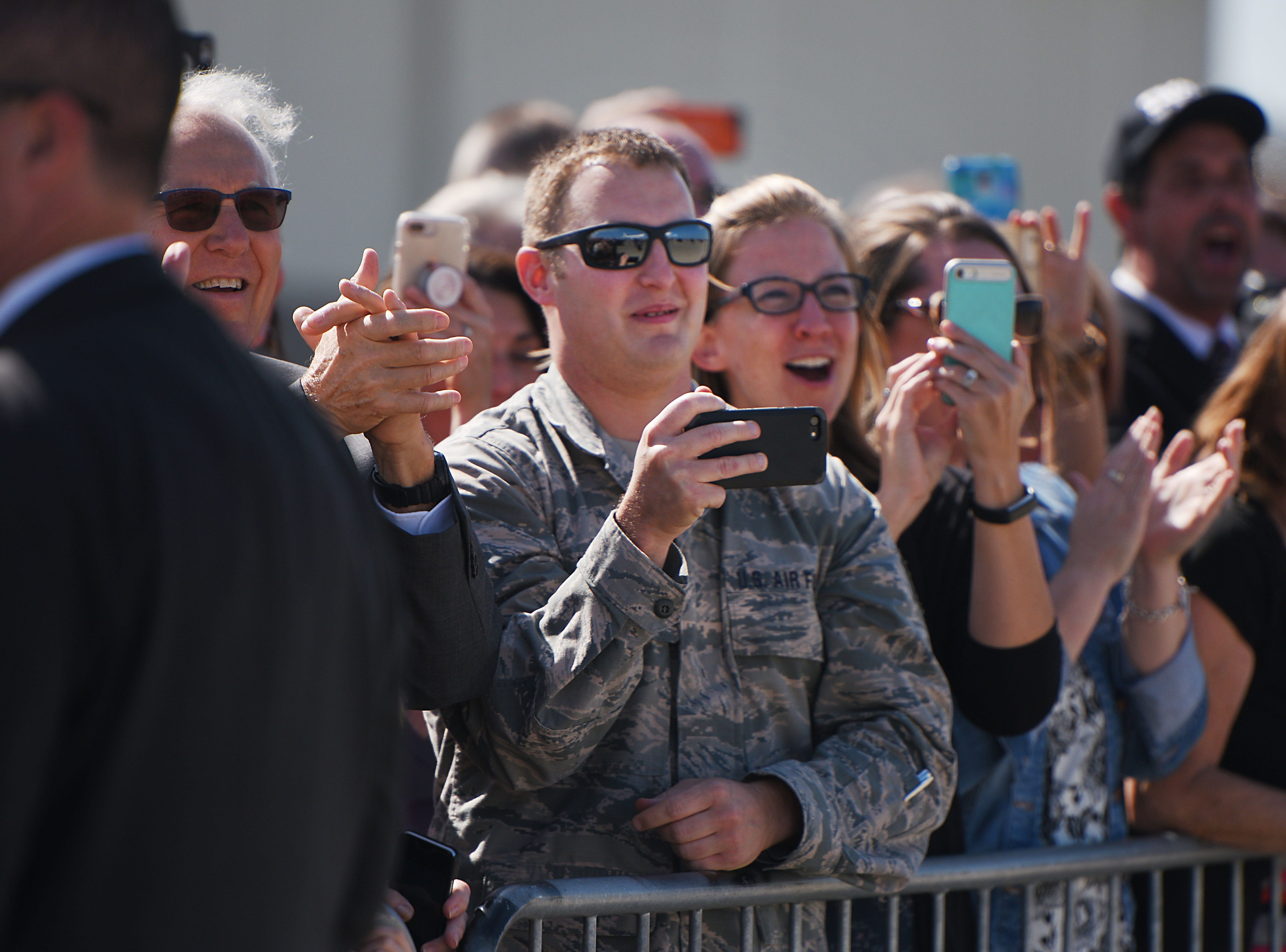 Friends and family wait on the tarmac to see President Donald Trump Friday, Sept. 7, at South Dakota Air National Guard in Sioux Falls.