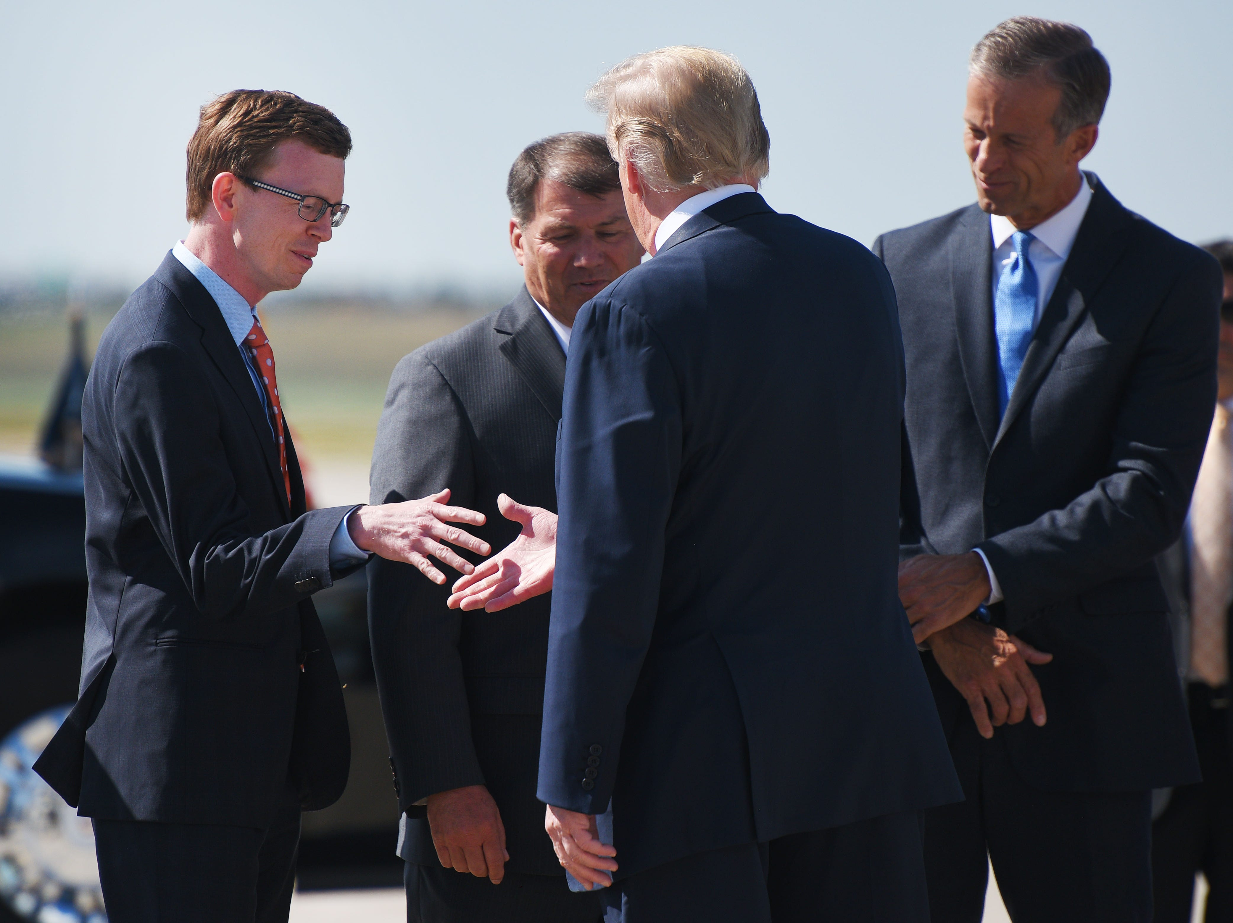 President Donald Trump shakes hands with Dusty Johnson after he lands Friday, Sept. 7, at South Dakota Air National Guard in Sioux Falls.
