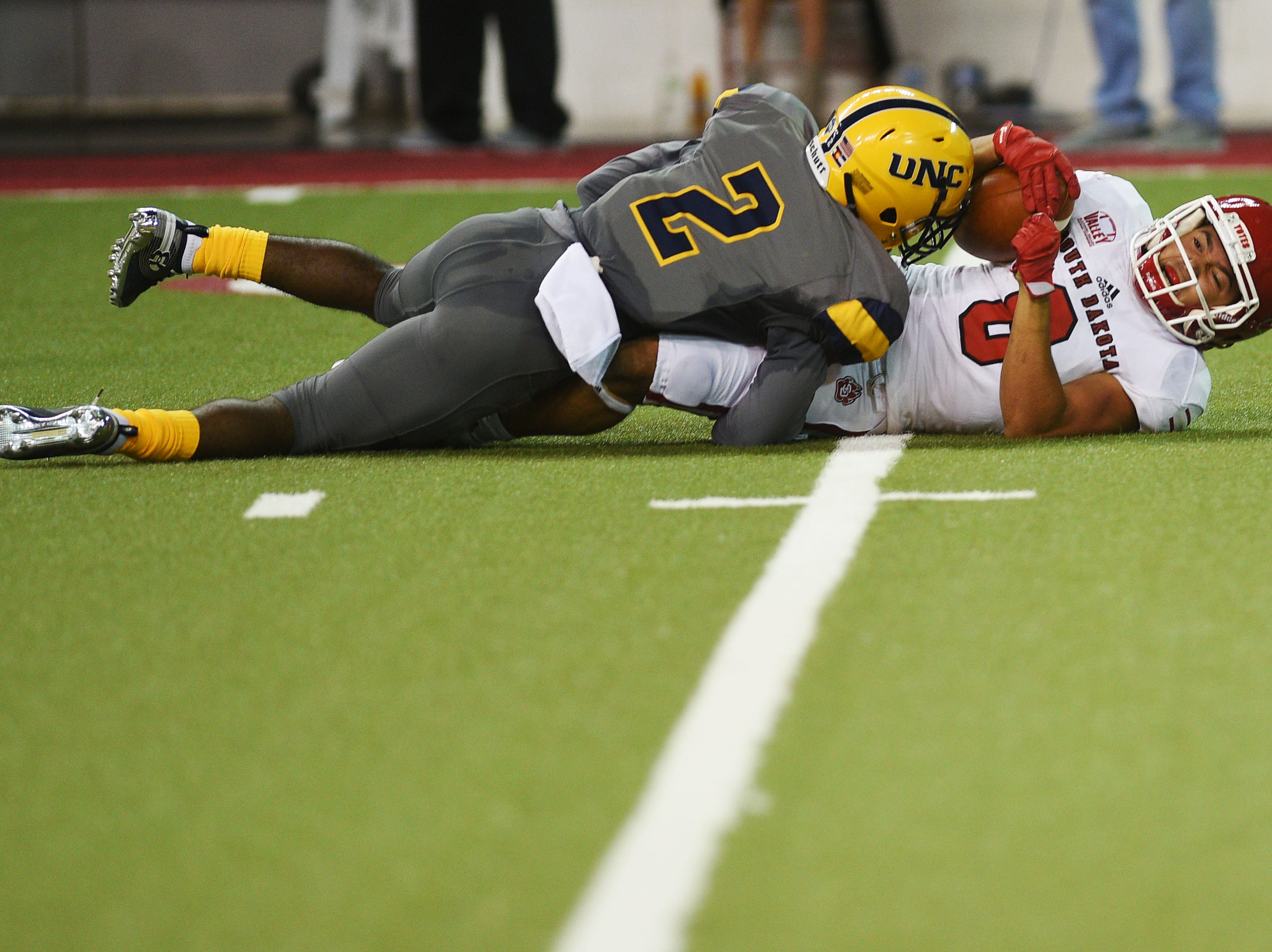 USD's Trystn Ducker is tackled by Northern Colorado's 	Isaiah Swopes during the game Saturday, Sept 8, at the DakotaDome in Vermillion.