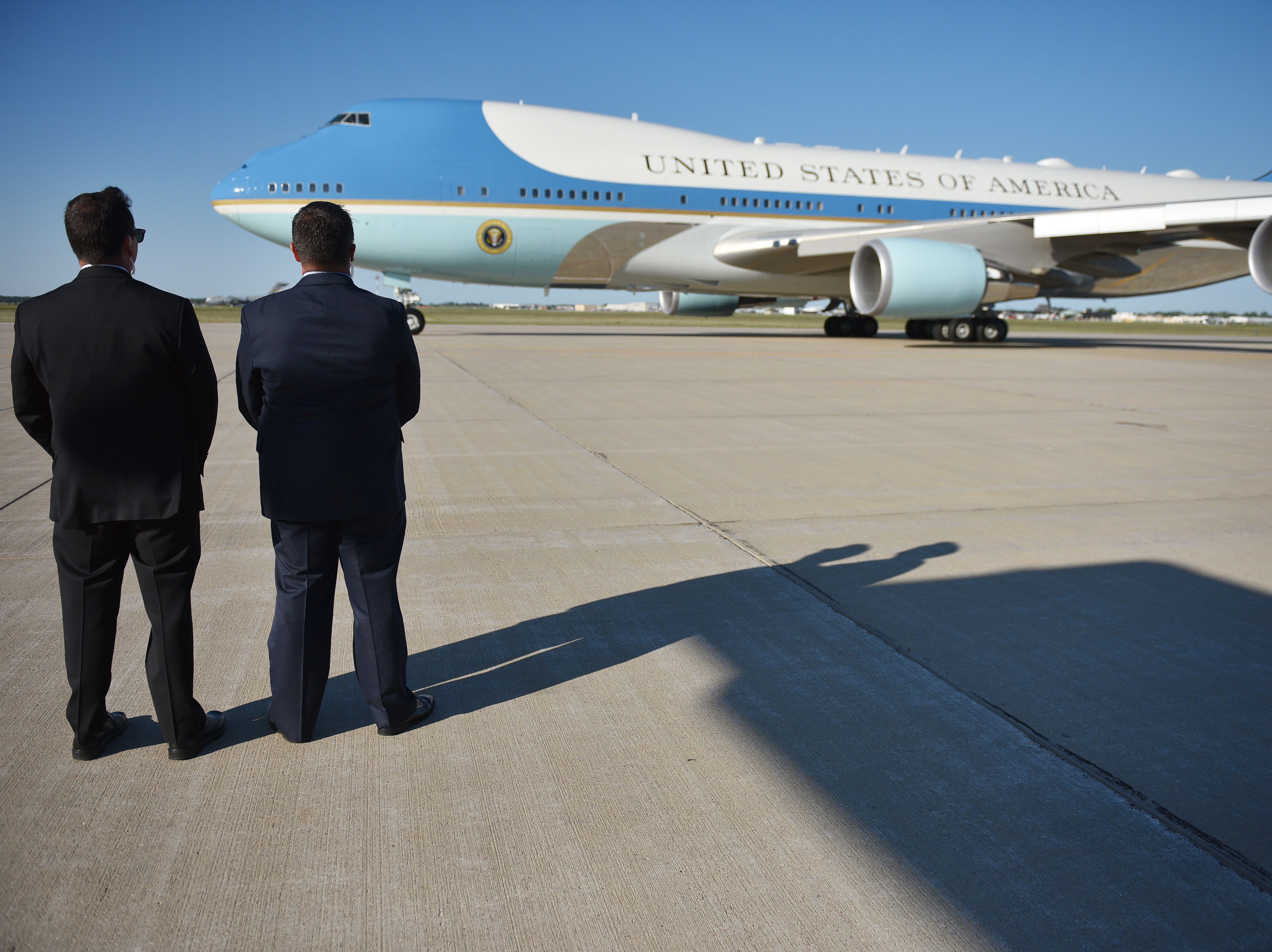 Security watches Air Force One take off after President Donald Trump's visit to Sioux Falls Friday, Sept. 7, at South Dakota Air National Guard in Sioux Falls.
