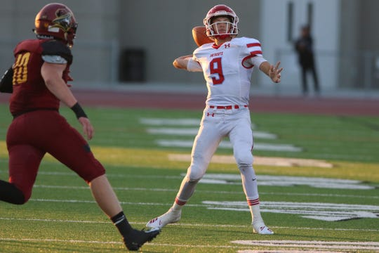 Lincoln's #9Terel Eisenbraun sets to throw the ball while Roosevelt's #10 Ethan Winter bares down on hiim.