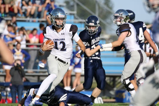 Ryder Kirsch of St Thomas More scrambles with the ball during Friday's game against West Central in Hartford.