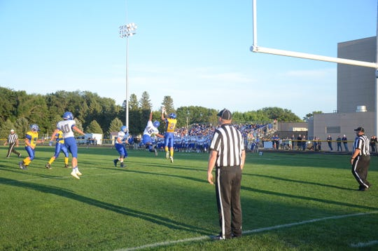 Garrett Minihan scores the 2-point conversion to give Canton a 8-0 lead on Friday, Sept. vs. SF Christian.