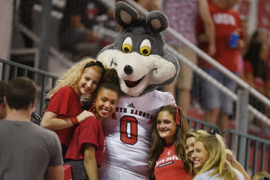 USD's mascot, Charlie, takes photos with students during the game against Northern Colorado Saturday, Sept 8, at the DakotaDome in Vermillion.