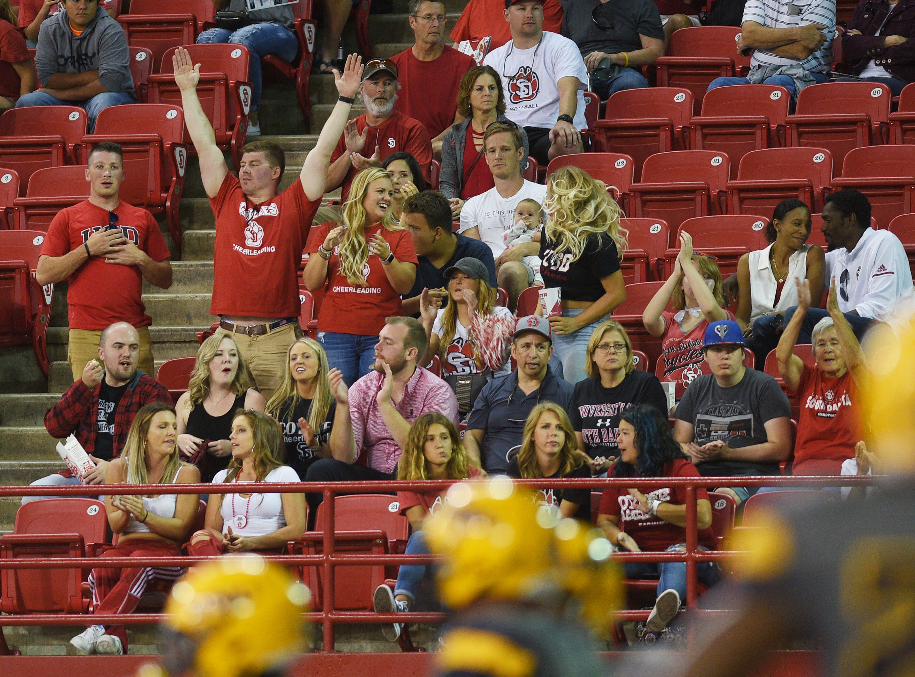 USD fans cheer after a touchdown against Northern Colorado Saturday, Sept 8, at the DakotaDome in Vermillion.