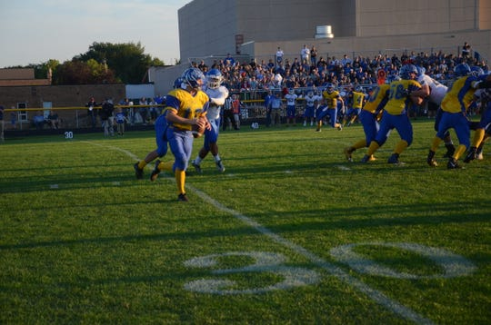 Canton quarterback Scott Peterson rolls out against SF Christian on Friday, Sept 7.