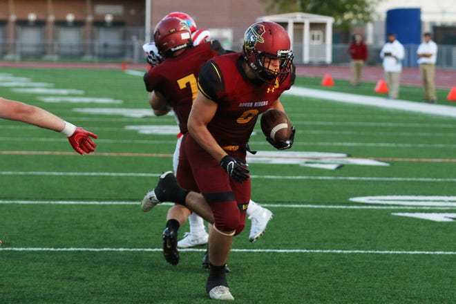 Roosevelt's  Aaron Kusler runs into the endzone during Roosevelt's win Friday night.