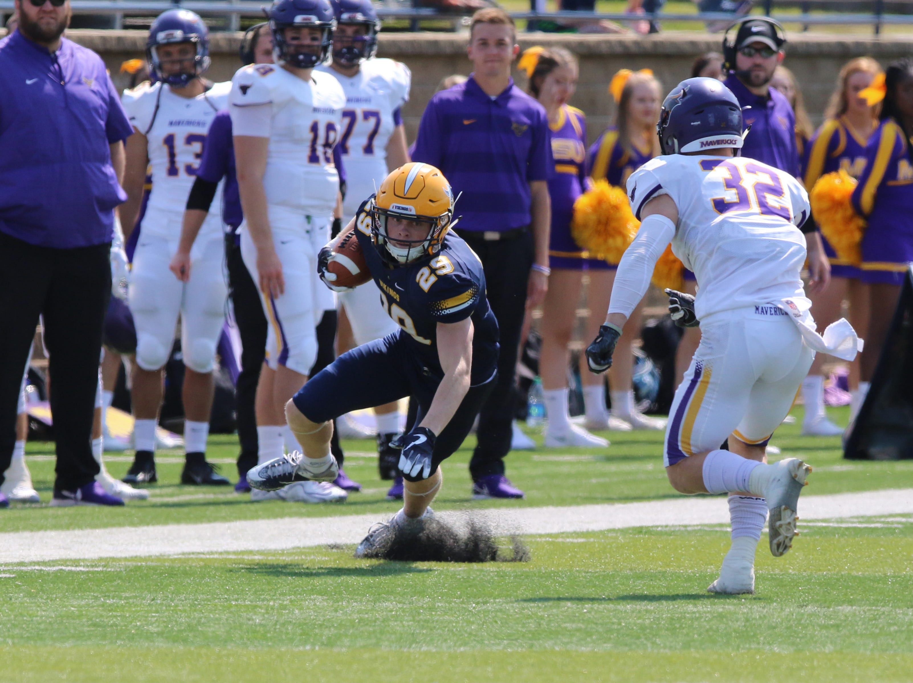 Augustana's Fr RB Braiden Petersen catches a pass from QB Kyle Saddler and turns to elude a defender during their game against Minnesota State-Mankato.