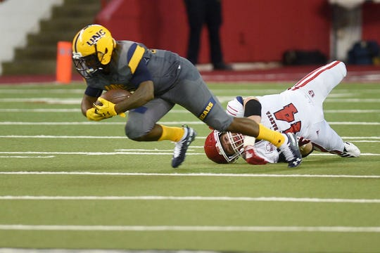 Northern Colorado's Milo Hall is tackled by USD's Darin Greenfield during the game Saturday, Sept 8, at the DakotaDome in Vermillion.