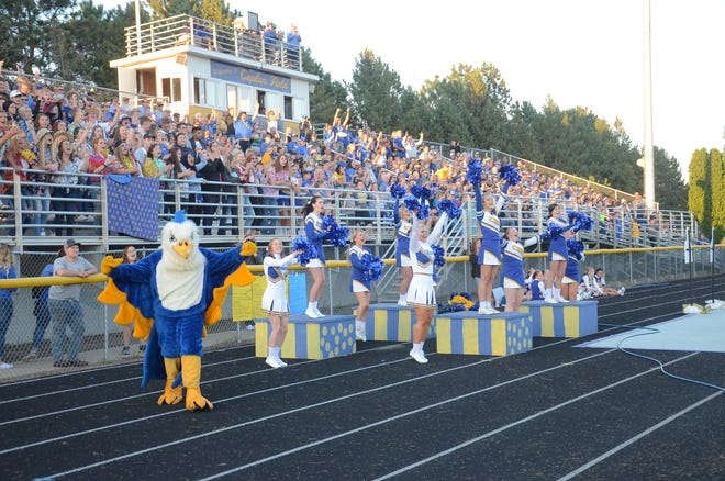 The Canton crowd cheers on a touchdown pass from Scott Peterson on Friday, Sept. 7.