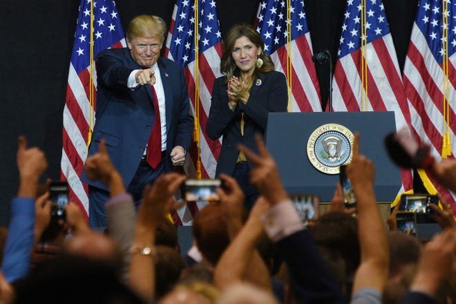 President Donald Trump and U.S. Rep. Kristi Noem speak Friday, Sept. 7, at South Dakota Air National Guard in Sioux Falls.