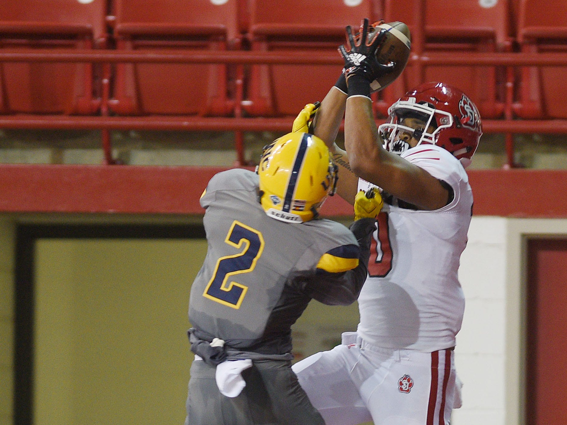USD's Reggie Crawford catches the ball in the end zone  against Northern Colorado's Isaiah Swopes during the game Saturday, Sept 8, at the DakotaDome in Vermillion.