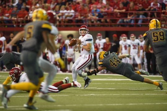 USD's Austin Simmons looks for an open pass during the game against Northern Colorado Saturday, Sept 8, at the DakotaDome in Vermillion.