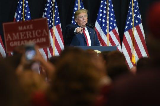 President Donald Trump speaks in September at the Denny Sanford Premier Center in Sioux Falls.