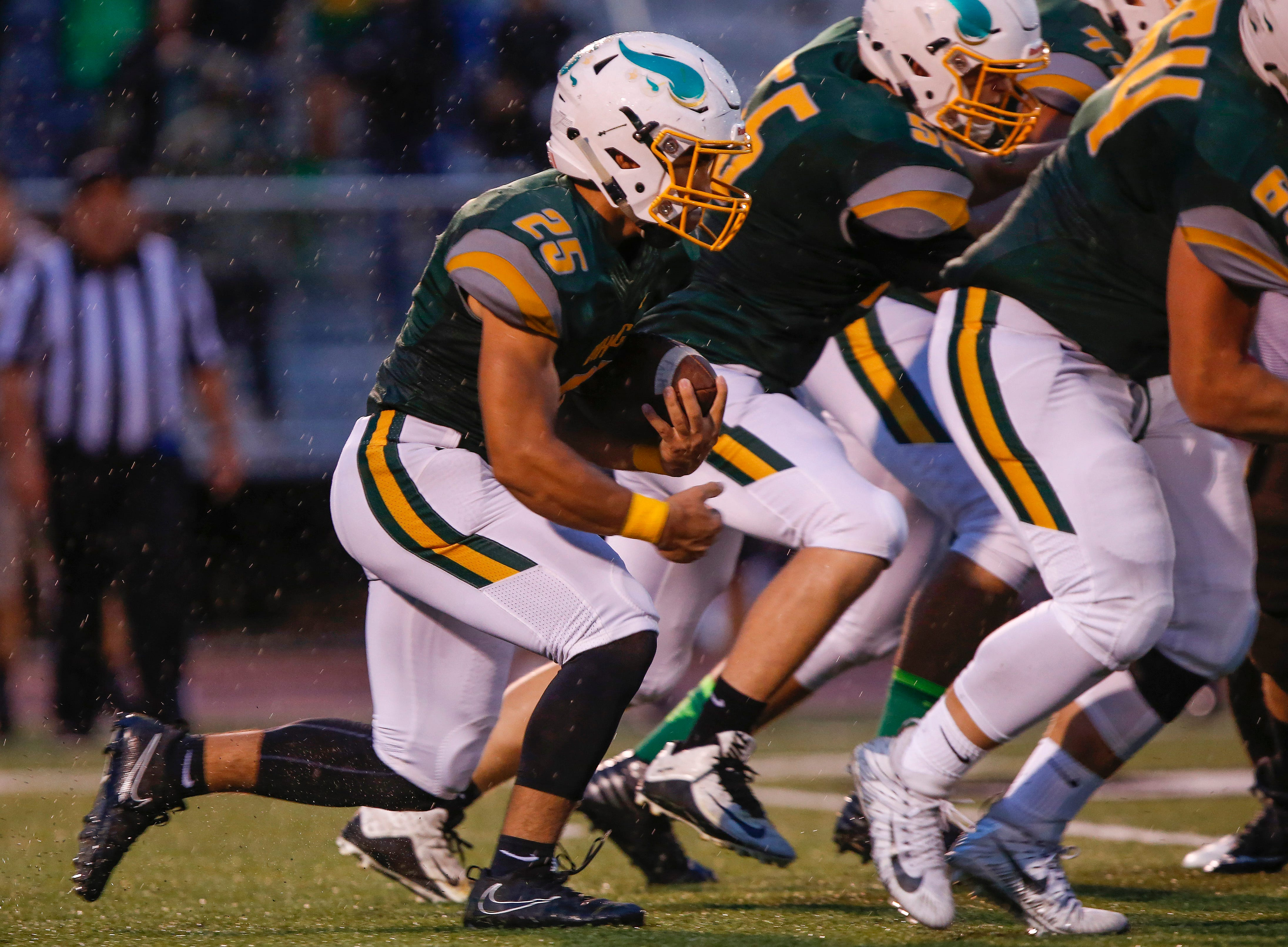 Scenes from the Kickapoo vs. Parkview football game on a soggy night at Parkview High School on Friday, Sep. 7, 2018.