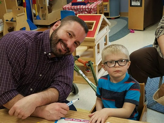 Nick Hostler, a special education teacher at McBride Elementary, with student Parker Atchley.