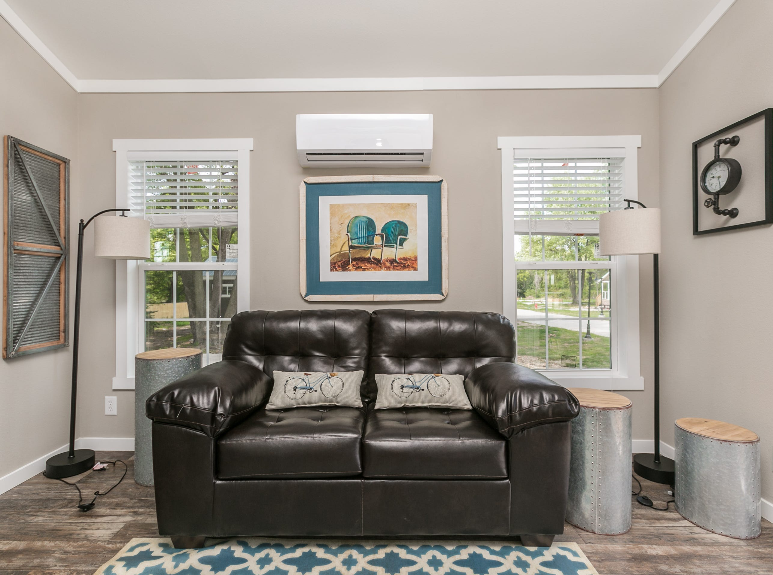 The living area is bright and cheerful, thanks to abundant natural light. Eden Village home donated by Mike and Mary Walker taken on September 4th, 2018.
