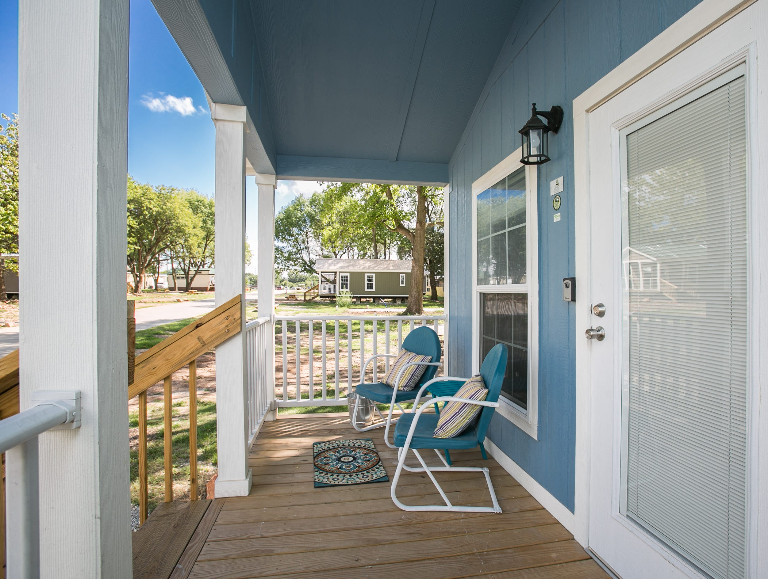 This cheery porch is ready for its new tenant to chat with visitors or just enjoy the day. Eden Village home donated by Mike and Mary Walker taken on September 4th, 2018.