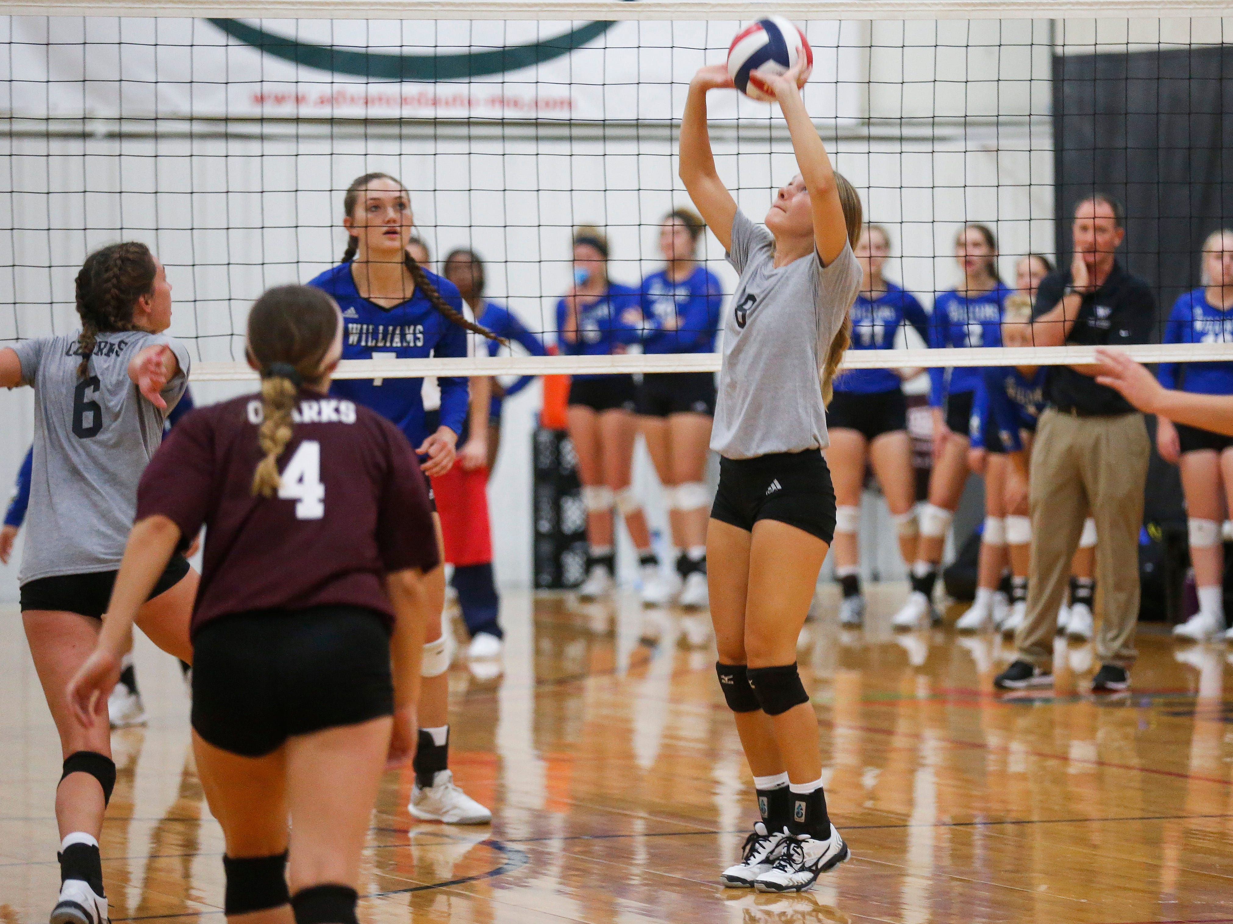 Rielly Dobbs (8), of the College of the Ozarks Bobcats, sets the ball in their game against the Williams Baptist Eagles during the 2018 Evangel Classic at The Courts in Springfield, MO., on Saturday, Sep. 8, 2018.