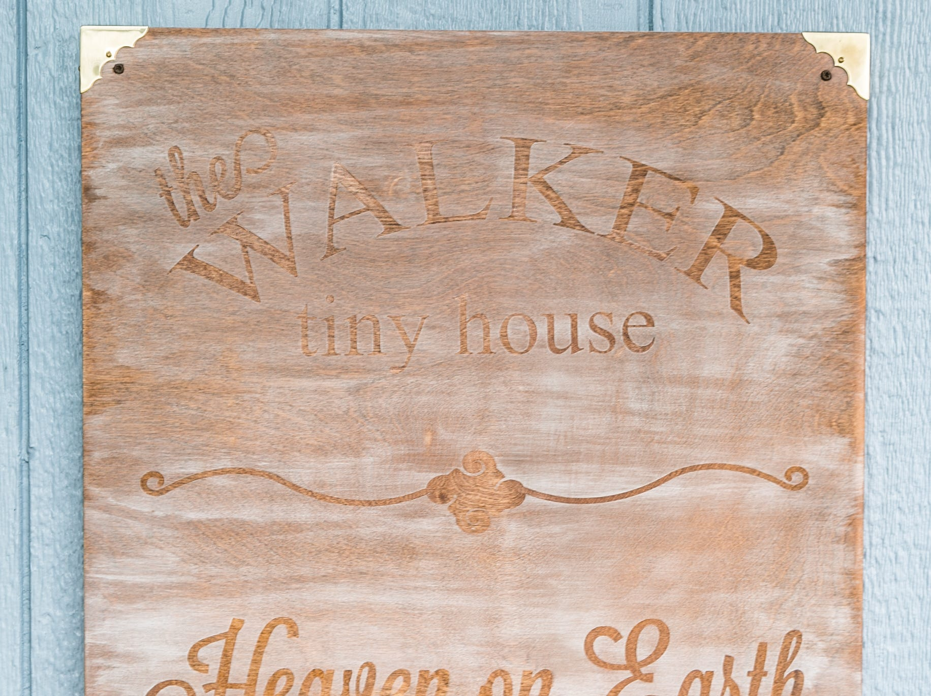 """: A plaque is inscribed with the donors' name and """"Heaven on Earth."""" Eden Village home donated by Mike and Mary Walker taken on September 4th, 2018."""
