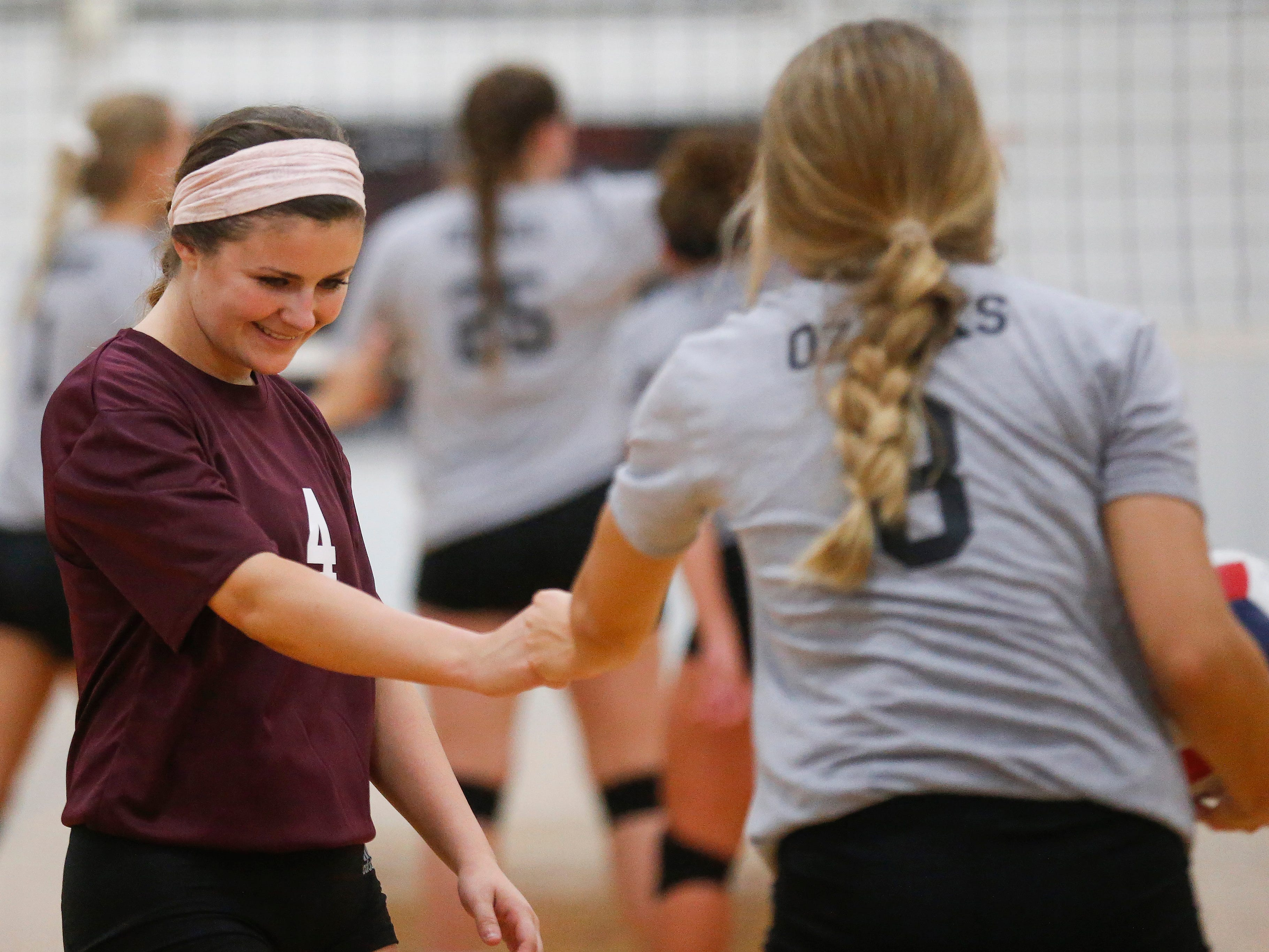 Haley Stallings (4) fist bumps Rielly Dobbs (8), both of the College of the Ozarks Bobcats during their game against the Williams Baptist Eagles during the 2018 Evangel Classic at The Courts in Springfield, MO., on Saturday, Sep. 8, 2018.