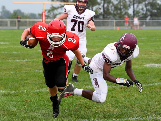 Riverheads' Devin Morris breaks the tackle and keeps running with the ball as Stuarts Draft's Jo'-el Howard goes down behind him during a football game played in Greenville on Friday, Sept. 7, 2018.