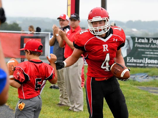 Riverheads' Blake Smith is congratulated by the ball boy after scoring a touchdown during a football game played in Greenville on Friday, Sept. 7, 2018.