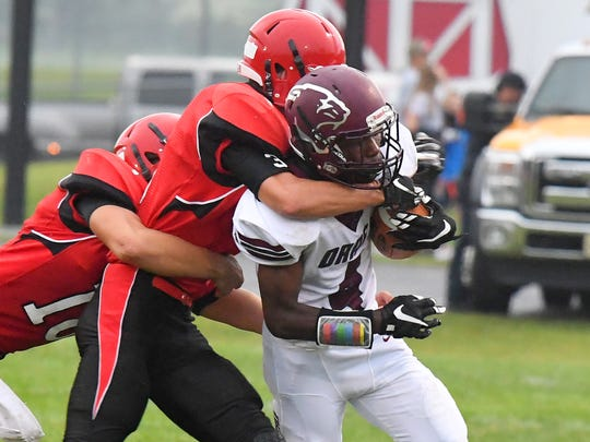 Stuarts Draft's Jo'-el Howard struggles as Riverheads' Drew Bond wraps his arm around him while trying to make the tackle during a football game played in Greenville on Friday, Sept. 7, 2018.