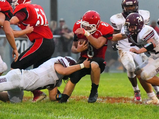 Riverheads' Zac Smiley protects the ball as he finds himself caught between two Stuarts Draft players during a football game played in Greenville on Friday, Sept. 7, 2018.