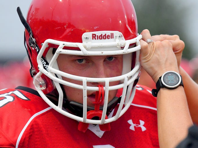 Riverheads' Deacon Moore holds steady as his face mask is adjusted during a football game played in Greenville on Friday, Sept. 7, 2018.