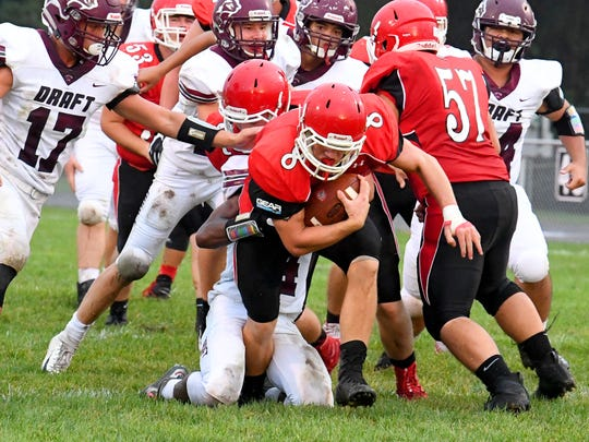 Riverheads' Zac Smiley still has the ball as he breaks free of a tackle attempt and keeps going during a football game played in Greenville on Friday, Sept. 7, 2018.