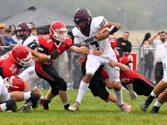 Stuarts Draft's Freddie Watkins has the ball as Riverheads' Davis Cogar, Jaden Phillips and Justin McWhorter get in on the tackle during a football game played in Greenville on Friday, Sept. 7, 2018.