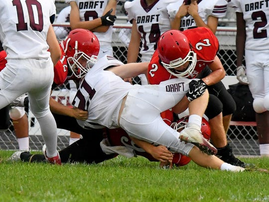 Riverheads' Cy Cox and Devin Morris work together to tackle Stuarts Draft ball Symeon Balser during a football game played in Greenville on Friday, Sept. 7, 2018.