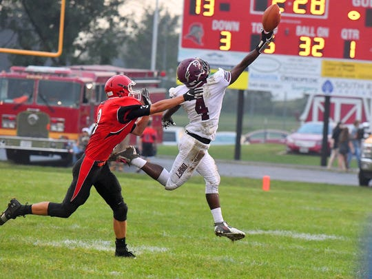 Stuarts Draft's Jo'-el Howard reaches to attempt to catch the ball, but its just out of reach during a football game played in Greenville on Friday, Sept. 7, 2018. Riverheads' Drew Bond pursues.