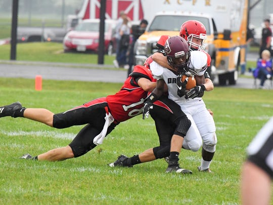 Stuarts Draft's Jo'-el Howard is tackled by Riverheads' Justin McWhorter and Drew Bond during a football game played in Greenville on Friday, Sept. 7, 2018.