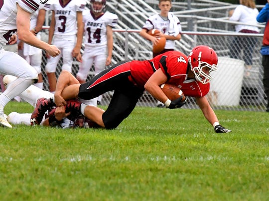 Riverheads' Blake Smith is tackled after a run during the Gladiators' 51-6 win over Stuarts Draft on Sept. 7.
