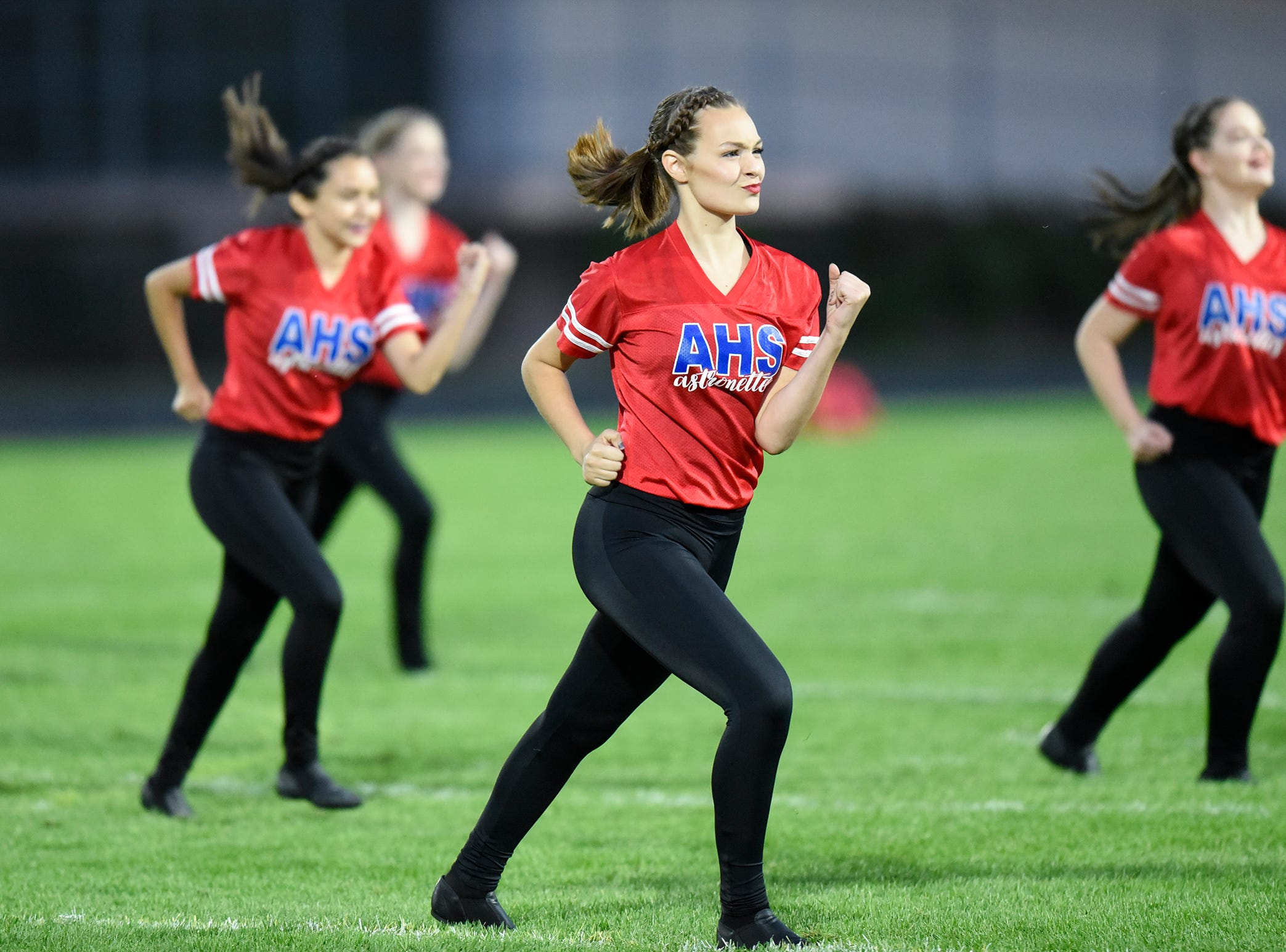 Apollo dance team members perform at halftime during the Friday, Sept. 7, game at Apollo High School in St. Cloud.