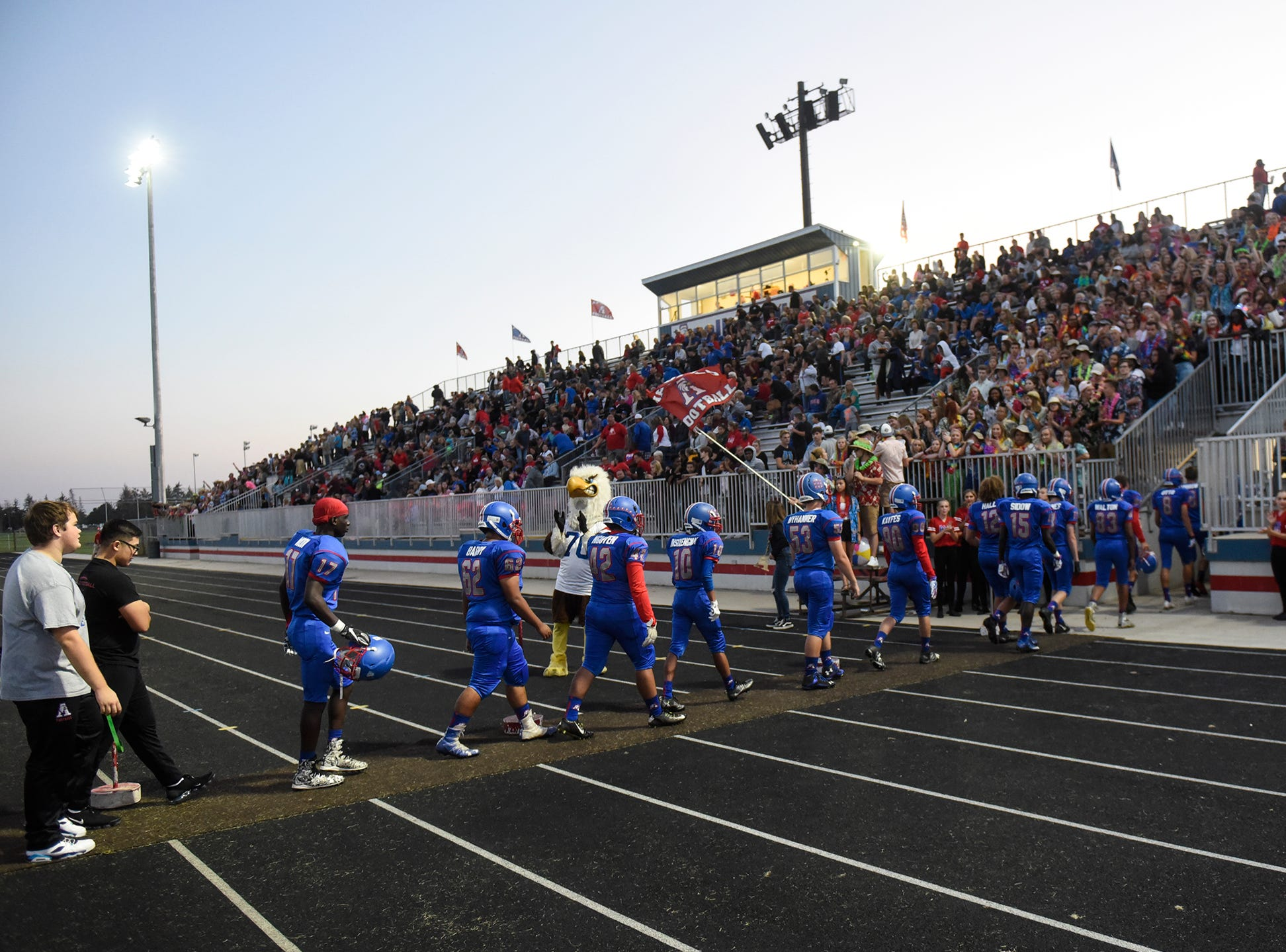 Apollo players leave the field at halftime during the Friday, Sept. 7, game at Apollo High School in St. Cloud.