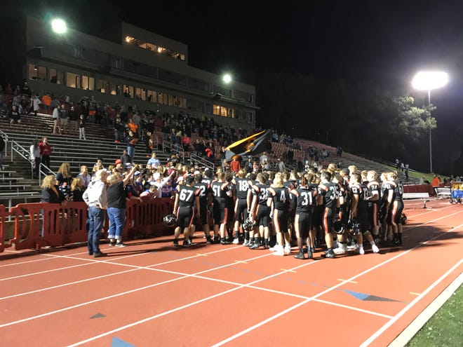St. Cloud Tech High School football players sing with student body fans after the Tigers' 32-26 win over Brainerd on Friday at Clemens Stadium in Collegeville.